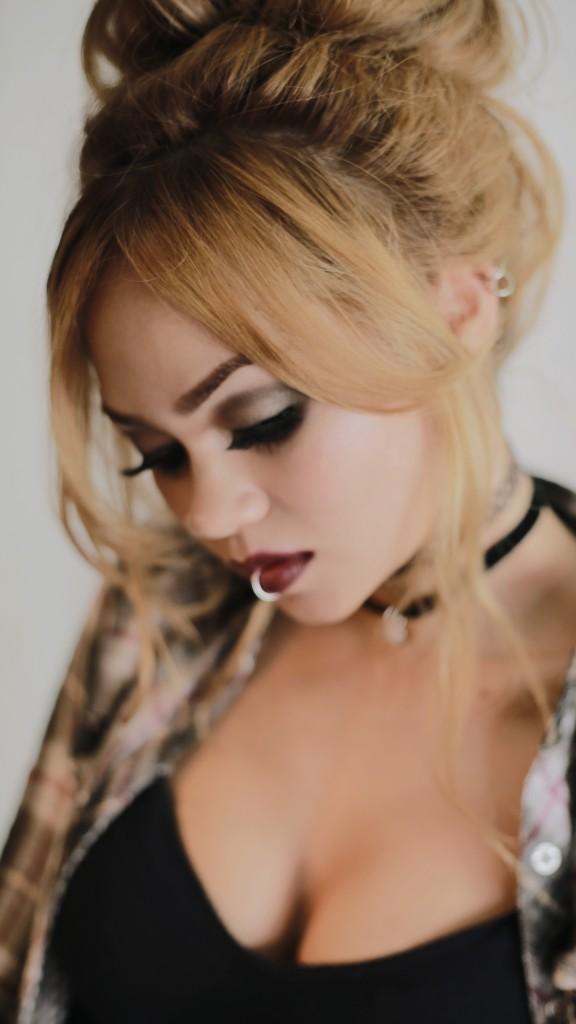 Rose Russo Grunge Makeup Messy Bun Hairstyle boobs